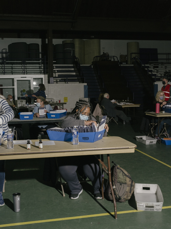 The ballot prep area where they unfold and flatten ballots to be scanned.